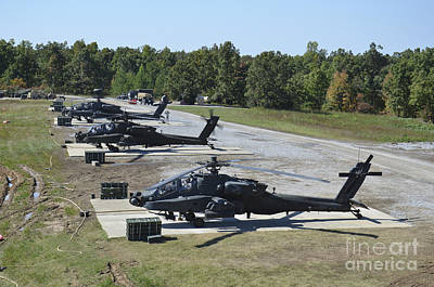 An Air Crew Starts Their Ah-64d Apache Poster