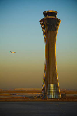 An Airplane Flies Past The Air Traffic Poster