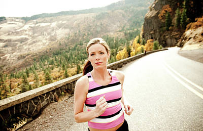 An Athletic Woman Jogging Poster
