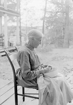 An Elder Woman Cutting Fruit On A Farm Poster by Stocktrek Images