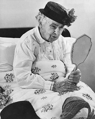 An Elderly Woman With A Mirror Poster