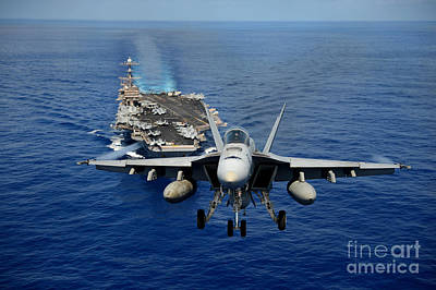 Poster featuring the photograph An Fa-18 Hornet Demonstrates Air Power. by Paul Fearn