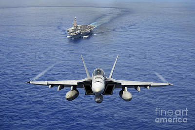 An Fa-18e Super Hornet Flying Above Uss Poster