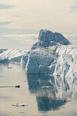 An Inuit Fishing Boat In Icebergs Poster