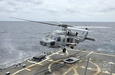 An Mh-60r Sea Hawk Helicopter Lifts Poster by Stocktrek Images