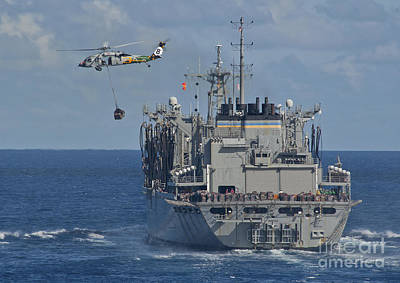 An Mh-60s Sea Hawk Conducts A Vertical Poster