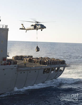 An Mh-60s Sea Hawk Helicopter Carries Poster