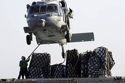 An Mh-60s Sea Hawk Picks Up Supplies Poster by Stocktrek Images