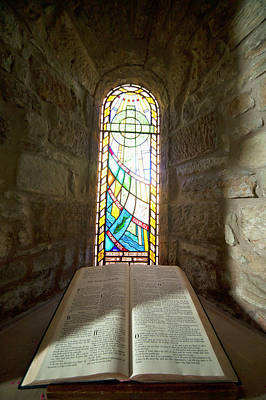 An Open Bible And A Stained Glass Poster