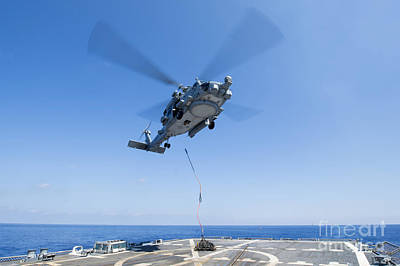 An Sh-60r Seahawk Delivers Supplies Poster