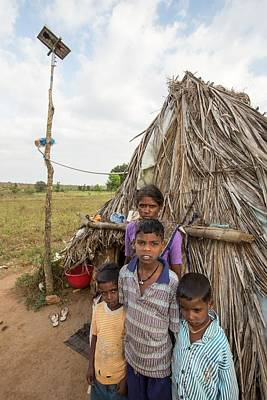 An Untouchable Family Outside Their Hut Poster