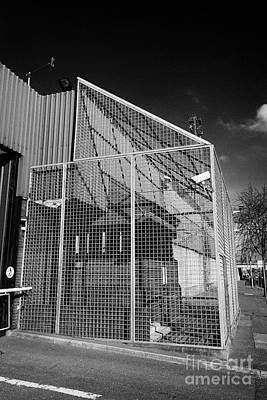 anti rpg cage surrounding observation sanger at North Queen Street PSNI police station Belfast North Poster