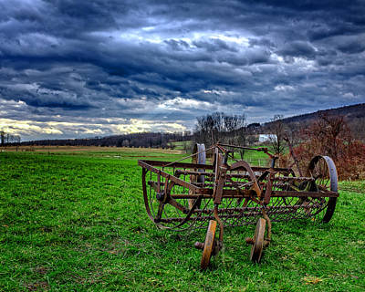Antique Hay Rake Under As Stormy Sky Poster by Chris Bordeleau