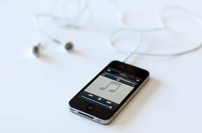 Apple Iphone 4s With Audioplayer And Earphones Poster by Frank Gaertner