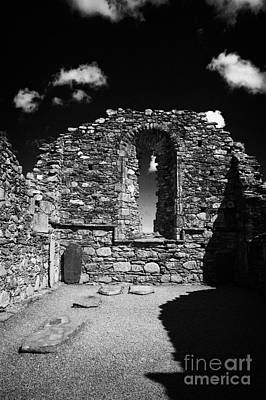 Arched Window In Ruins Ruined Remains And Gravestones Inside The Cathedral At Glendalough Monastic Site Poster by Joe Fox