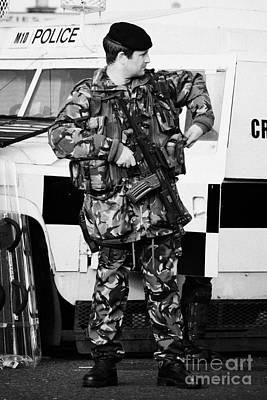Armed British Soldier At Psni Landrover On Crumlin Road At Ardoyne Shops Belfast 12th July Poster by Joe Fox