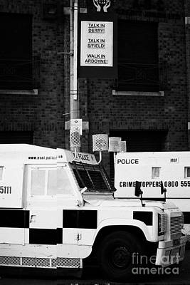 Armoured Psni Land Rovers Under Protest Sign Banner On Crumlin Road At Ardoyne  Poster