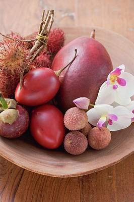 Assorted Exotic Fruits In A Dish With Orchids Poster