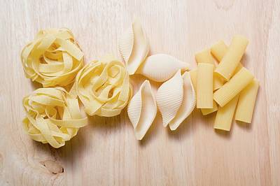 Assorted Pasta On Wooden Background Poster