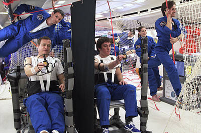 Astronauts Training In Free-fall Poster