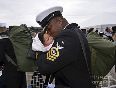Aviation Ordnanceman Kisses His Newborn Poster