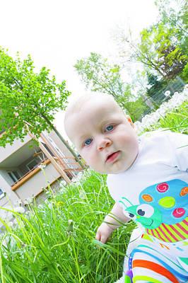 Baby Boy In A Garden Poster by Wladimir Bulgar