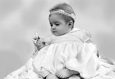 Baby Girl Holding Flower Black And White Poster by Sally Rockefeller