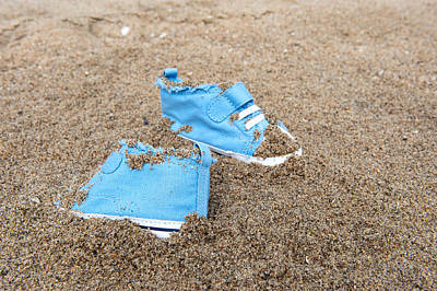 Baby Shoes On Beach Poster