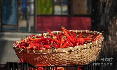 Basket With Red Chili Peppers Poster