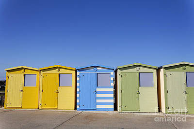 Beach Huts At Seaford In East Sussex In England Poster by Robert Preston