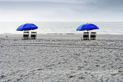 Beach Umbrellas On A Cloudy Day Poster