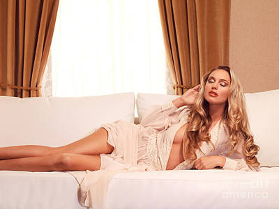 Beautiful Glamorous Woman With Long Blond Hair Lying On Sofa Poster
