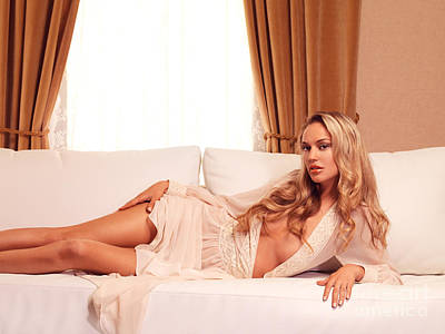 Beautiful Sexy Woman With Blond Hair Lying On Sofa Poster