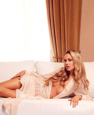 Beautiful Young Woman With Long Blond Hair Lying On White Sofa Poster
