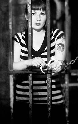 Poster featuring the photograph Behind Bars by Jim Poulos