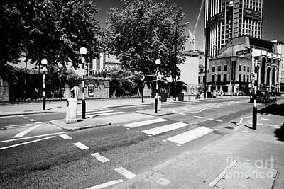 belisha beacon pedestrian crossing across road in central London England UK Poster