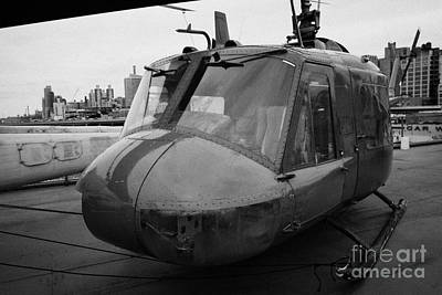 Bell Uh1 Huey On Display On The Flight Deck Of The Uss Intrepid At The Intrepid Sea Air Space Museu Poster by Joe Fox