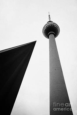 berliner fernsehturm Berlin TV tower symbol of east berlin with the roof of the nearby pavilion Germany Poster by Joe Fox