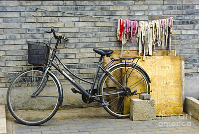 Bicycle In An Alleyway Poster by John Shaw