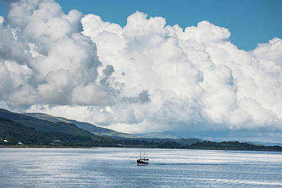 Billowing Cloud And A Boat In The Ocean Poster