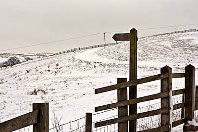 Blank Wooden Signpost On Snow Covered Moorland Poster by Ken Biggs