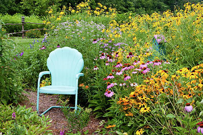 Blue Chair And Various Flowers Poster