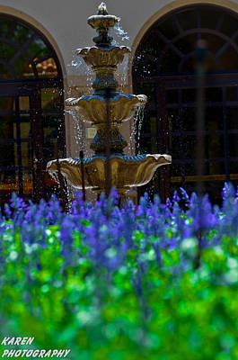Blue Flowers And A Fountain Poster