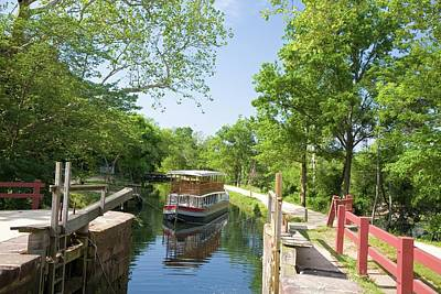 Boat Approaching An Open Canal Lock Poster by Jim West