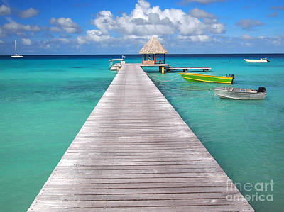 Boats At The Jetty In A Tropical Turquoise Lagoon Poster
