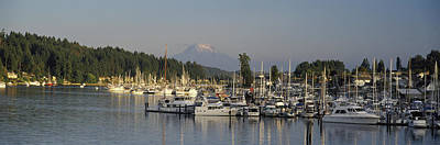 Boats Docked At A Harbor With Mountain Poster