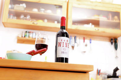 Bottle Of Red Wine On A Kitchen Table Poster
