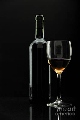 Bottle Of Wine And Wineglass Over Black Poster by Josep Maria Penalver