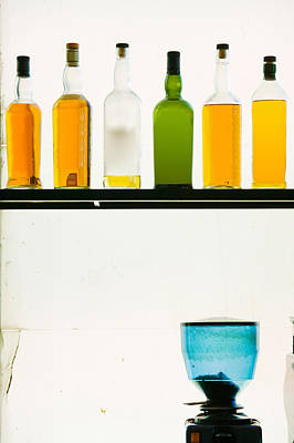 Bottles Displayed At The Bookworm Cafe Poster