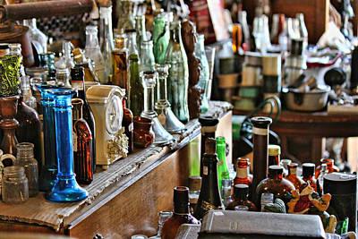 Bottles In The Old Stuff Shop Poster by Lynn Jordan
